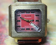 Bulova - Large and Chunky Square Case, Scarce Red Dial featuring a sideways Day and Date widow at the 4 o'clock position, with a 23 Jewel Automatic Movement Wristwatch - (circa 1973)