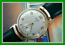 Elgin - De Luxe - Box and Tags - 17 Jewels and 4 Adjustments Movement Wristwatch - (Circa 1950s)