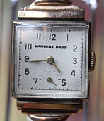 Lambert Bros. - Square 10K Gold Filled Case - 17 Jewel Hafis Watch Company Mechanical Wind Movement wristwatch - (circa 1940s)