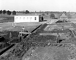 Dozier School - Dining hall construction with White House in background, 1936