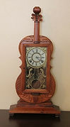 Violin Shaped Hand-Carved Case - 8-Day Time and Strike Movement - Shelf Clock - (circa 1960s)