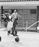 On June 18, 1964, James Brock, the manager of the motel, pours muriatic acid into the pool in an effort to get a group of white and black integrationists out of the former Monson Motor Lodge's swimming pool.