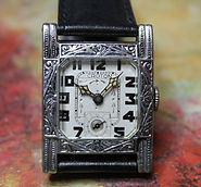 Croton - Exquisite Art Deco Tank Style with a Ornately Engraved Hinged Nickel Case and a Stunning Dial with 15 Jewels. The Art Deco Era Poster Child Wristwatch - (circa 1920s)