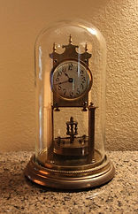 German - 400 Day Clock - Disk Pendulum - Round Dial and Case - (circa 1915)