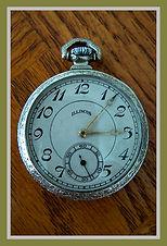 Illinois - 12 Size, Ornately Engraved 14 Karat White Gold 25 Years Wadsworth 3 Piece Hinged Case with a Quality Damaskeened 17 Jewel Adjusted Movement – Pocket Watch - (circa 1917)