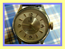 Sovereign, Ensemble - Outer Rim Cream Colored Starburst Dial Wristwatch - (Circa 1950s)