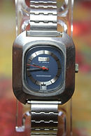 Buler - Huge Long Barrel Case - Blue Dial - 17 Jewel Mechanical Wind Sports Wristwatch - (circa 1970s)