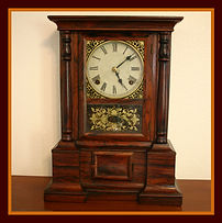 Atkins Clock Company, Bristol, CT. - London Model - Solid Rosewood Case - 8 Day Mechanical Movement - Shelf Clock - (circa 1863 - 1876)