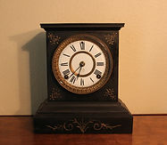 Ansonia Clock Company - Black Cast Iron Shelf Clock - (circa 1890s)