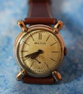 Bulova - 14K Gold Filled Ships Wheel Case - 21 Jewel Mechanical Wind Movement wristwatch - (circa late 1930s)