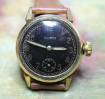 Illinois - Round Gold Plated Case - Black Dial - Illinois Mechanical Wind Movement wristwatch - (circa 1931)