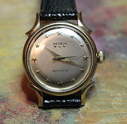 Benrus - High Quality Self-Winding Movement, Applied Stars for Hour Markers, Sculpted and Curved Lugs, 10K Gold Filled Case Wristwatch - (circa 1950s)