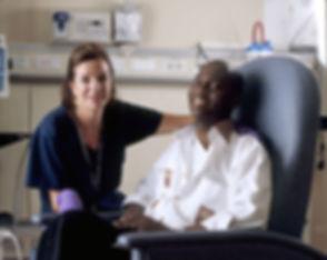 755px-Nurse_poses_with_cancer_patient.jp