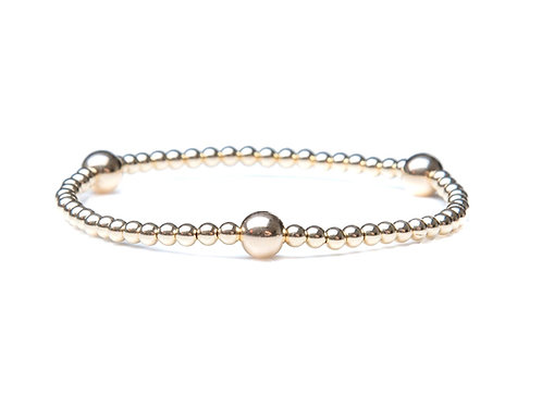 14kt gold bracelet with accent beads