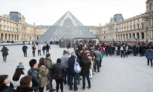 Lining up at the Louvre