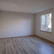 Living Room with Luxury Vinyl Floors.jpe
