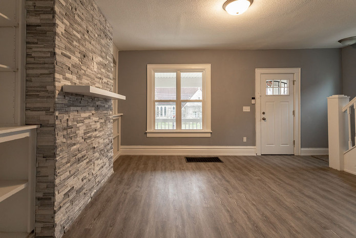 Front room with stone wall