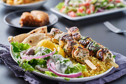 greek chicken souvlaki platter with pita bread, salad and rice.jpg