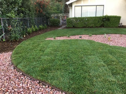 After Multicolor rock & Lawn Landscaping