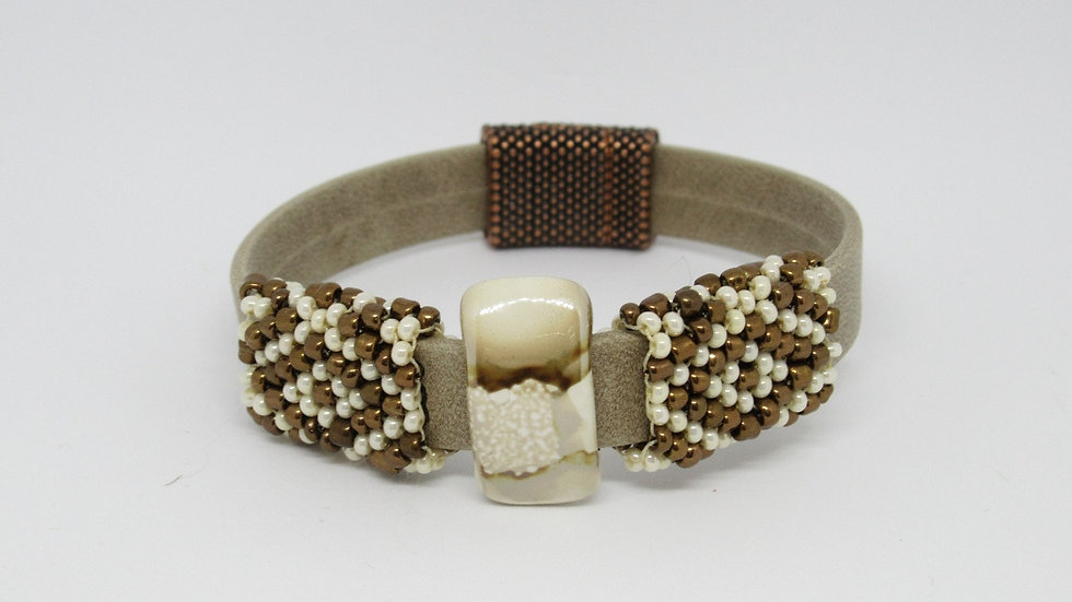 Tan leather-suede flat band bracelet with ivory-gold sleeves