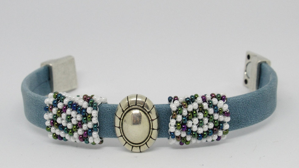 Light blue leather flat band bracelet with hand beaded multicolored sleeves