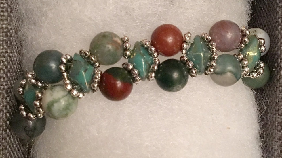 Beaded bracelet with green and soft red stones