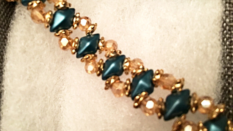 Beaded bracelet with  amber color crystals