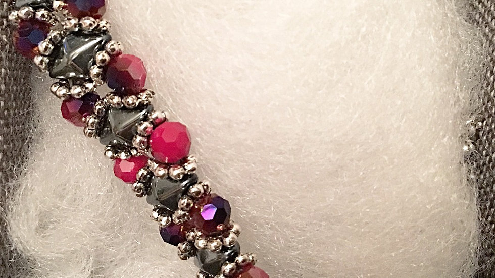 Beaded bracelet with red crystals and silver beads