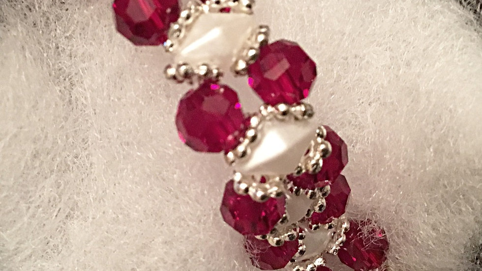 Beaded bracelet with red crystals and white beads