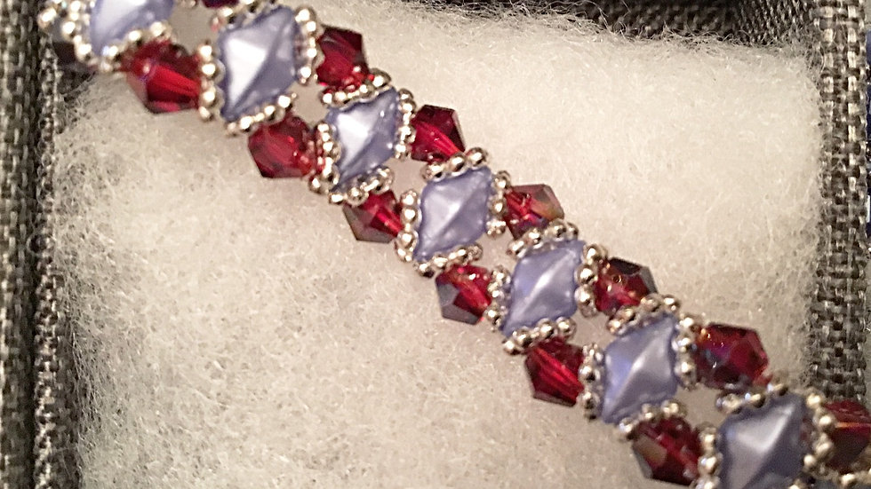 Beaded bracelet with ruby crystals and light blue separators