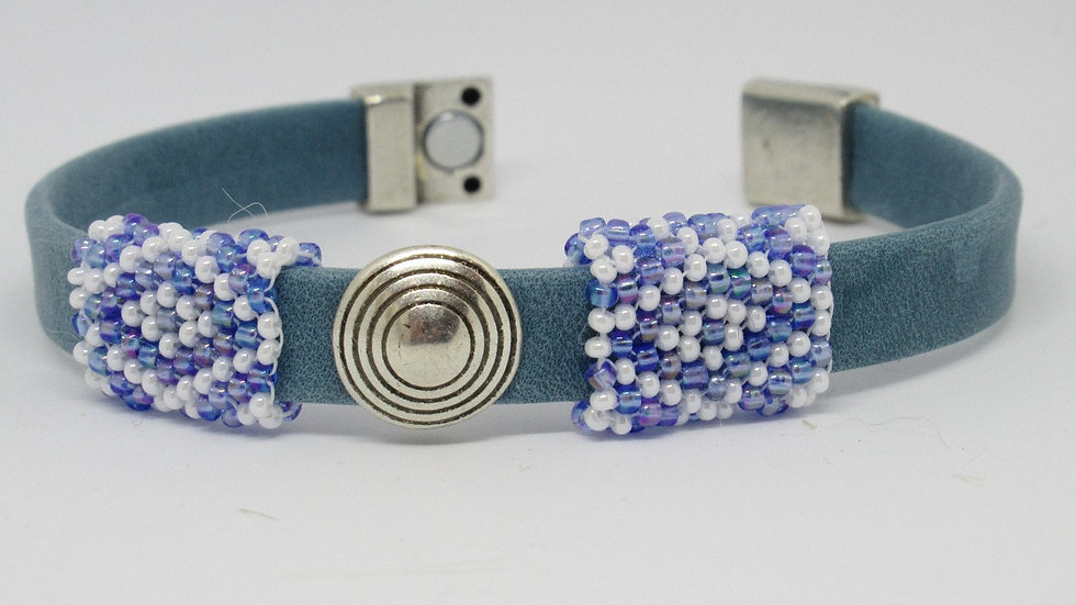 Light blue leather flat band bracelet with hand beaded  sleeves