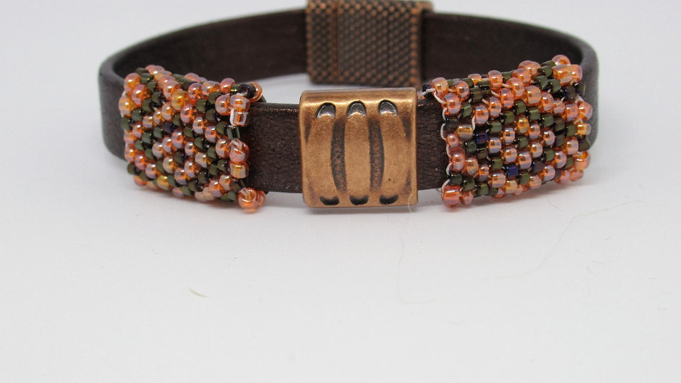Copper Leather flat band bracelet with hand beaded orange-brown sleeves