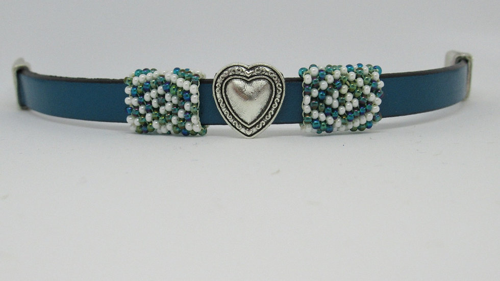 Turquoise leather flat band bracelet with hand beaded turquoise-white sleeves.