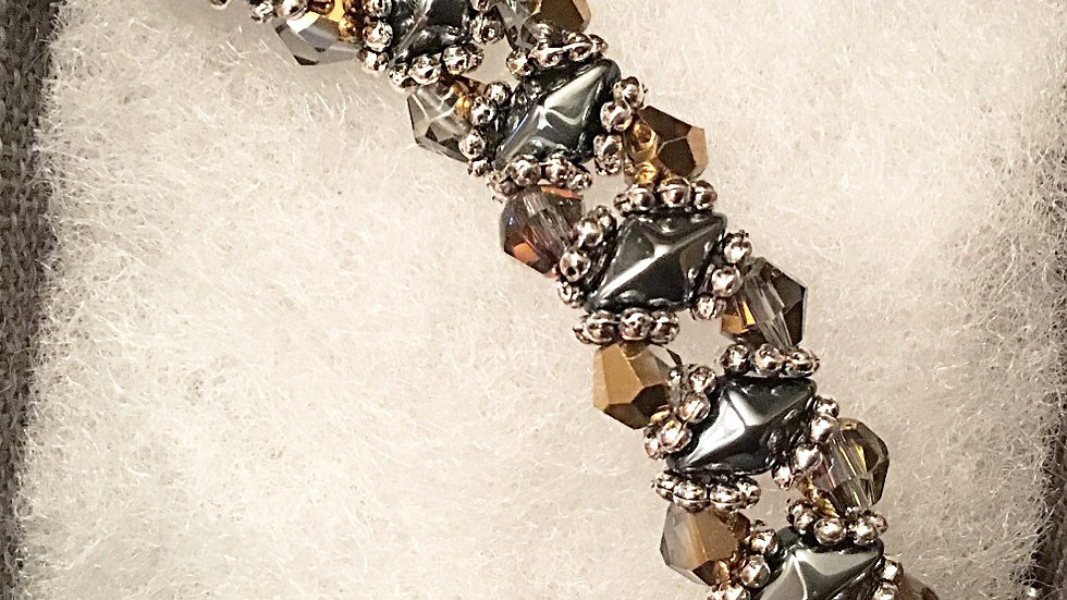 Beaded bracelet with  crystals and silver separators
