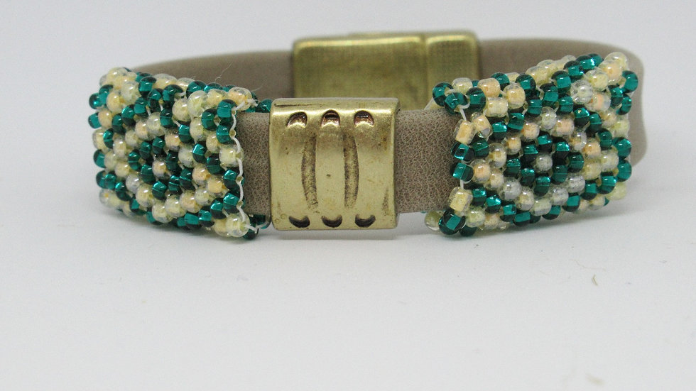 Leather-suede flat tan bracelet with hand beaded green-ivory sleeves