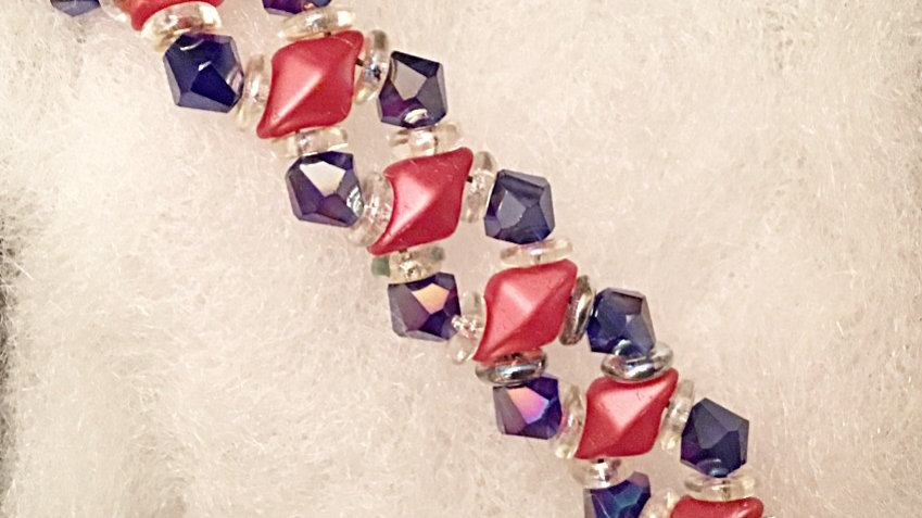 Beaded bracelet with dark blue crystals and red separators