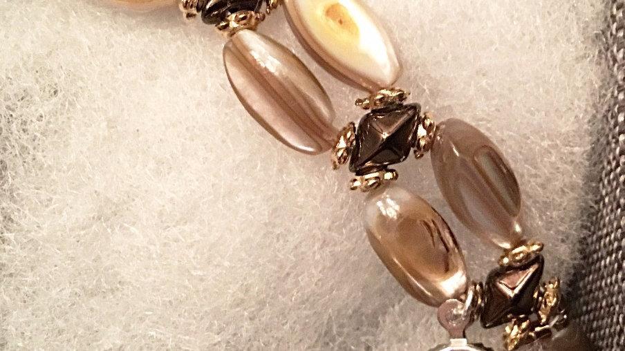 Beaded bracelet with cream stones