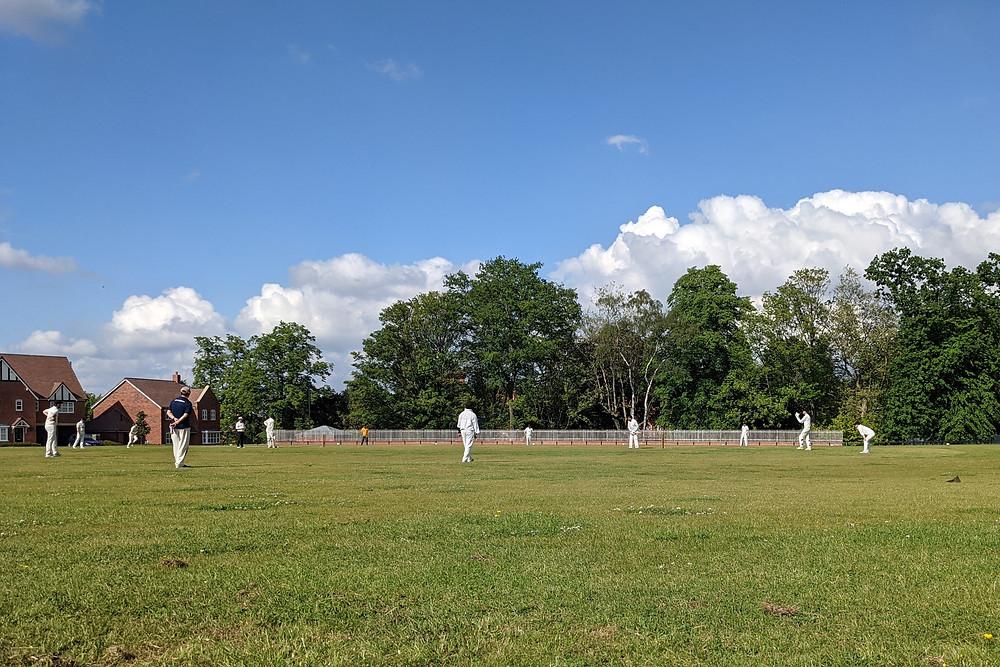 Blue sky over cricket ground