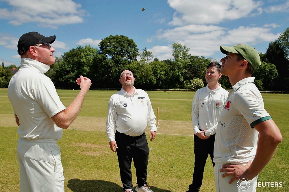Umpires observes the coin toss between the two captains