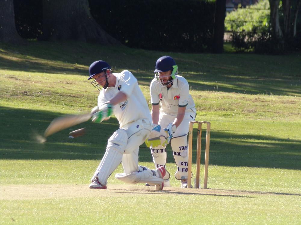 Action shot of batter James