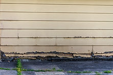 rotting old clapboard siding on an old g