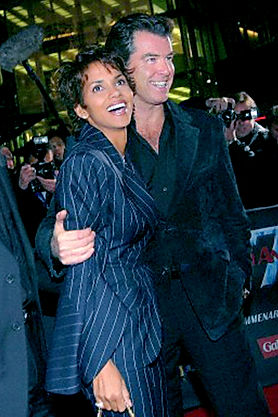 Halle Berry  shown wearing Lloyd Klein to attend a moveie premier  and she is accompanied by actor Pierce Brosnan