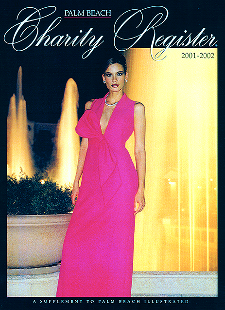 Lloyd Klein grabs the cover of the Palm Beach Charity Register