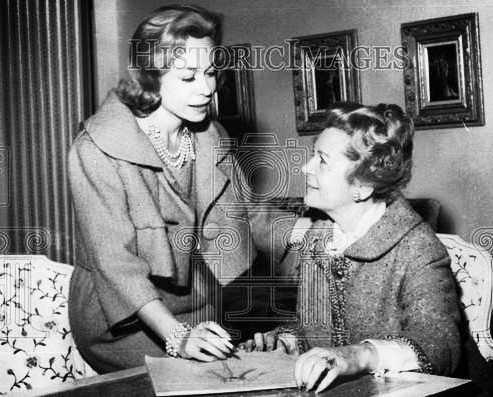 Lynn Manulis and her Mother Martha Phillips shown in a photo of the two reviewing designer sketches in 1963.