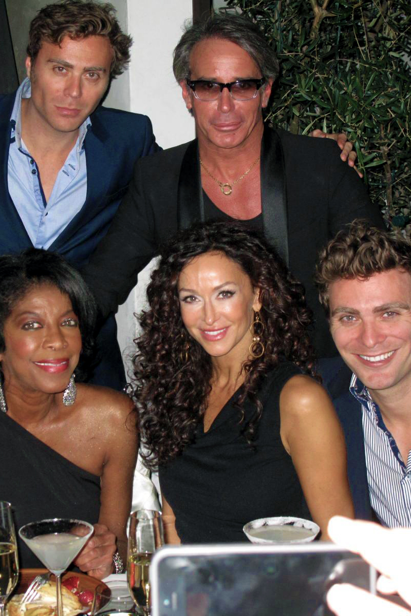 Lloyd Klein celebrating his birthday with Natalie Cole-Sofia Milos- and the EC2 Twins.jpg