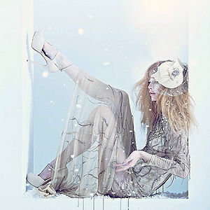 Winter fashion editorial featuring Lloyd Klein Couture