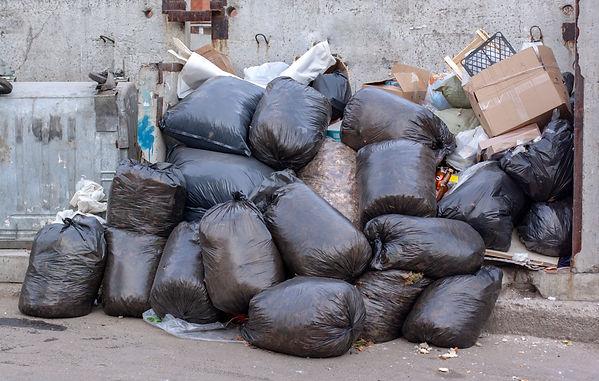 Rubbish large-pile-black-plastic-garbage
