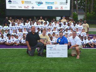 Dewitt Donates to Kids & Pros Football Camp in Savannah