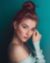 model wearing teal colors.jpeg