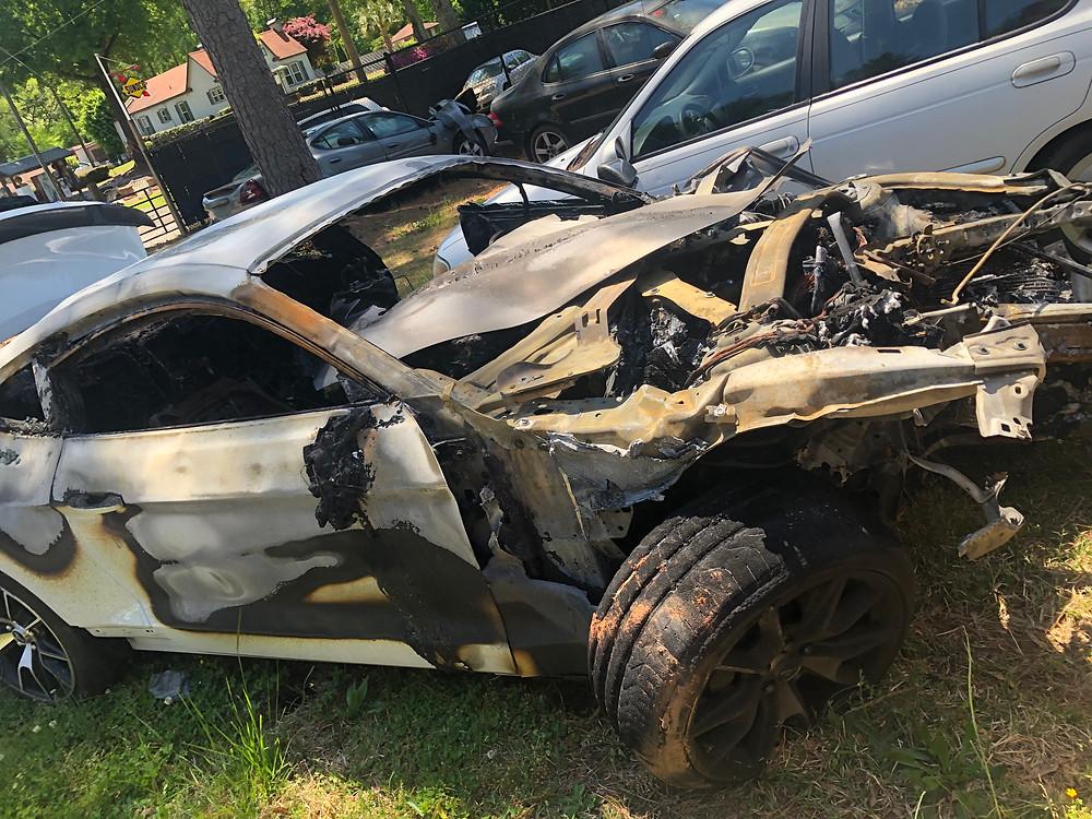 a car totaled in a fire